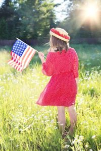 girl with flag in field Donald Trump Presidential Candidate